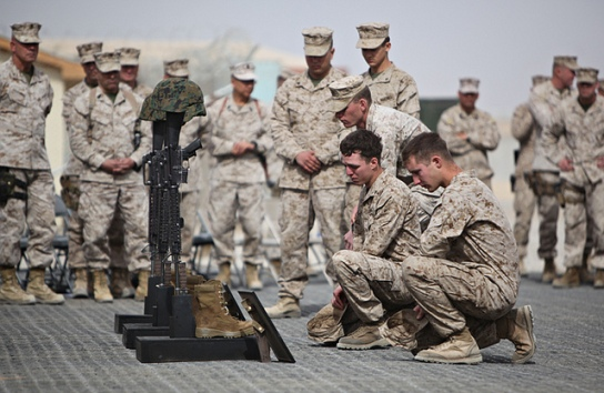 Soldiers honoring a fallen comrade