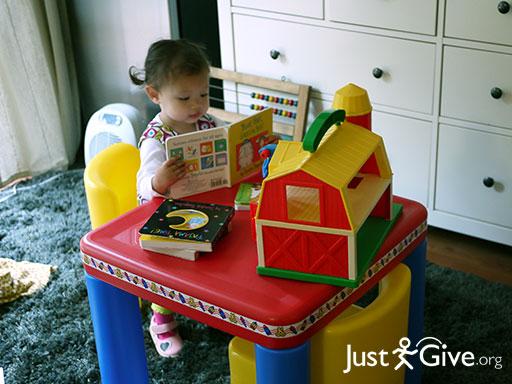 Toddler enjoying books