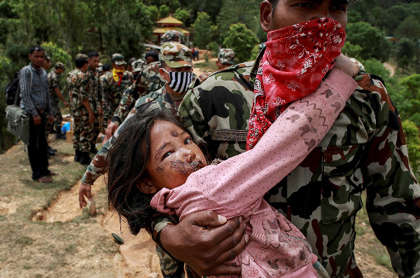 An injured girl is carried to a helicopter following the earthquake in Sindhupalchowk, not far from Kathmandu (Danish Siddiqui/Reuters)